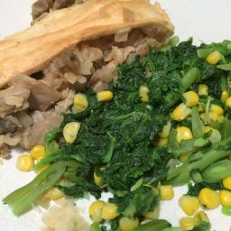 Steak and mushroom pie, served with spinach and sweetcorn