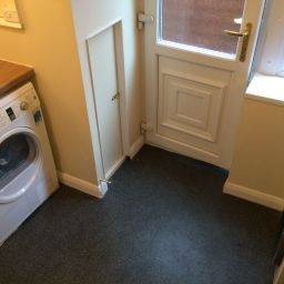 Utility room with tumble dryer