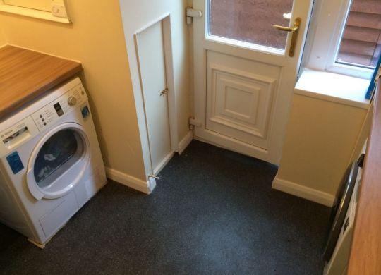 Utility room with tumble dryer