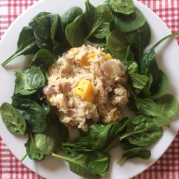 Butternut squash risotto served with fresh spinach