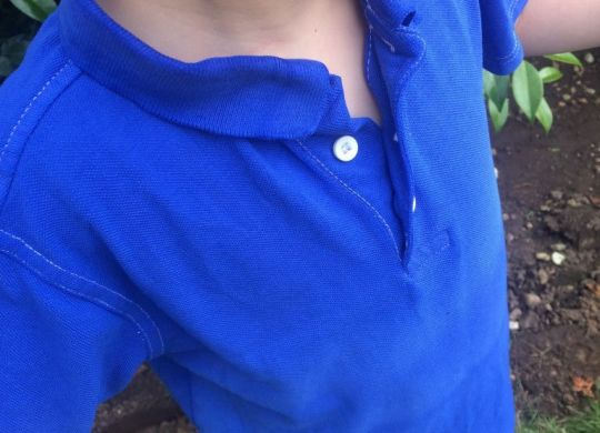 Bright blue polo shirt on boy