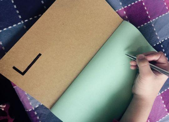 Green doodle notebook
