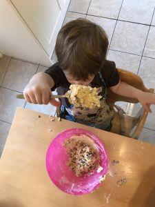 Boy showing camera rock cake mixture