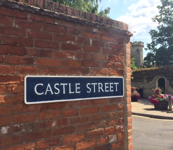 Castle Street road sign with castle in background