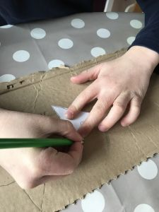 Drawing stars on cardboard