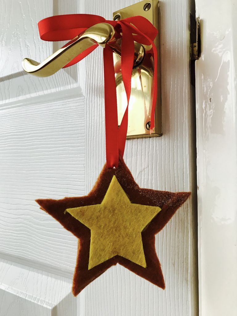 Star hanging with ribbon from a door handle
