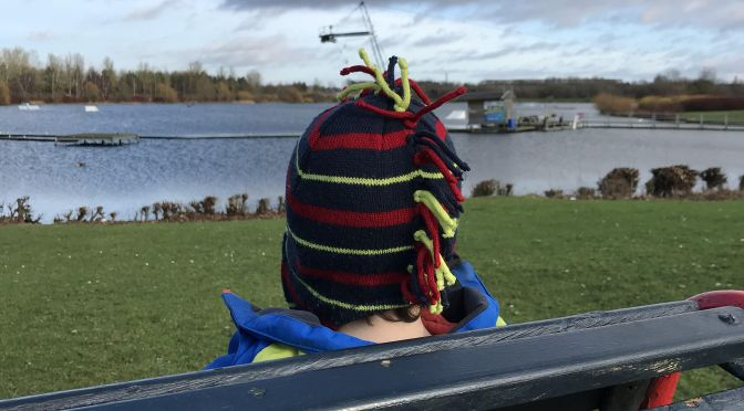 Child looking across a lake