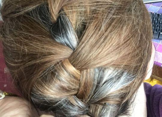 Grey hairs coming through
