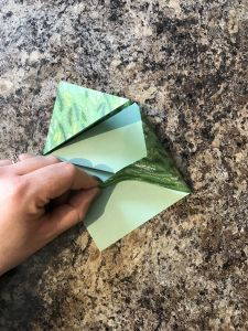 Folding the corner under - origami