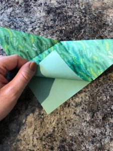 Folding the top sheet back up - origami