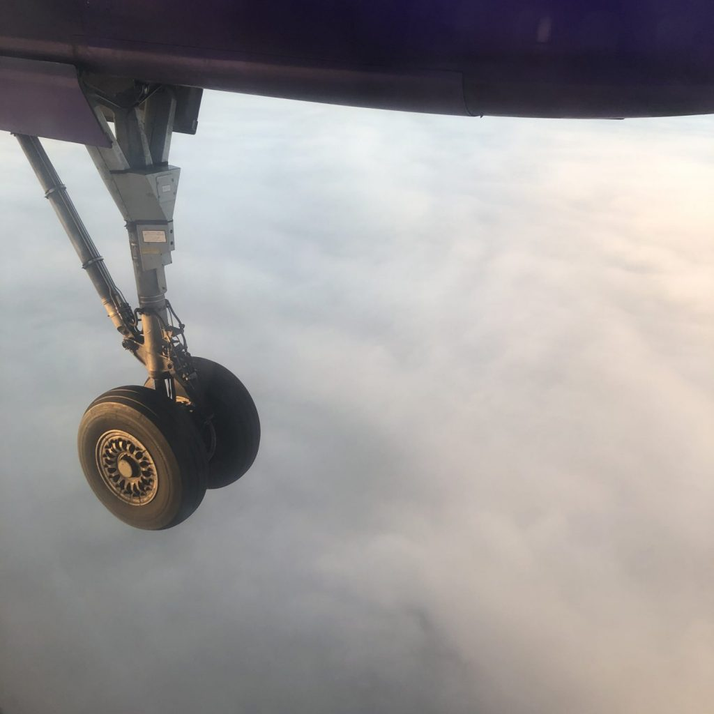 Aeroplane wheel in the clouds
