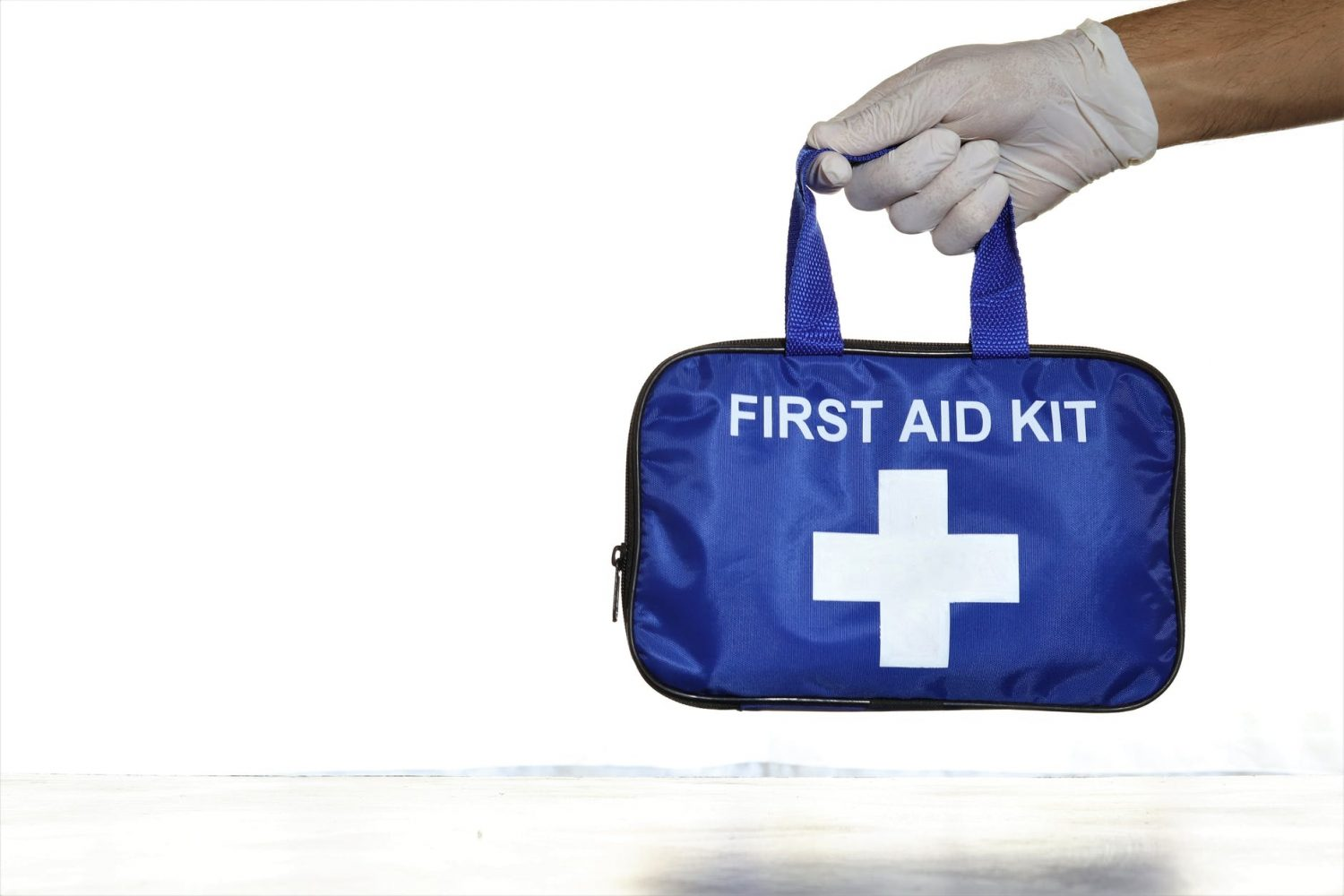 person holding first aid kit
